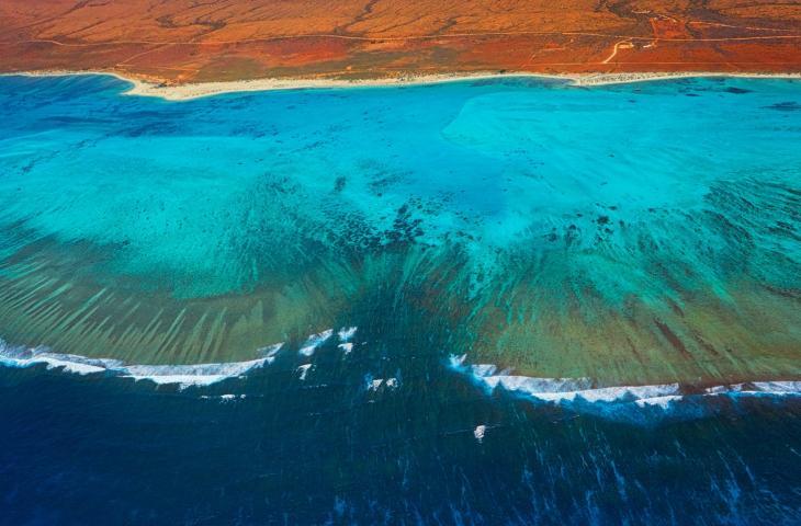 I cambiamenti climatici consumano le coste australiane – In a Bottle